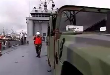 Loading vehicles on Army watercraft