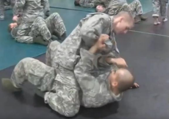 Soldiers receiving combatives training